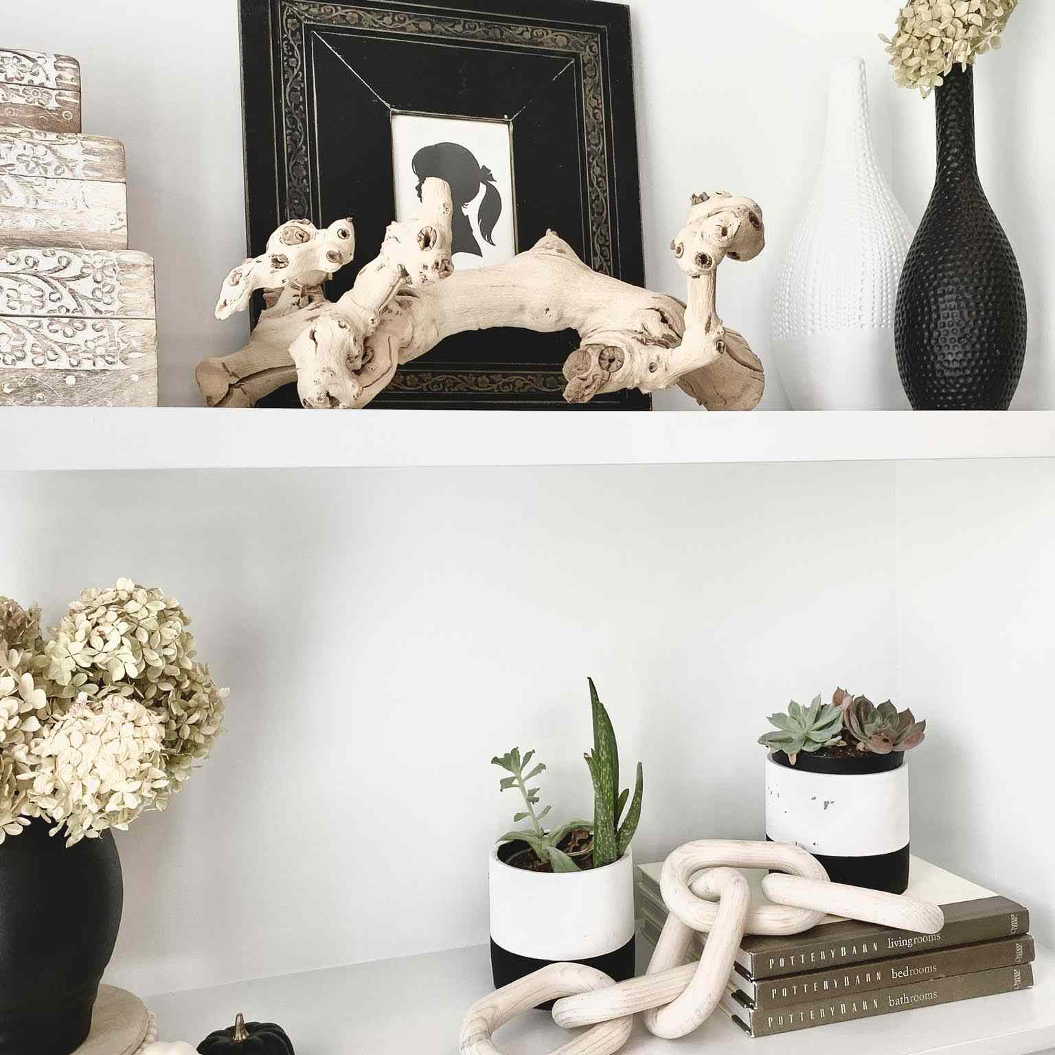 White shelving with driftwood decor.