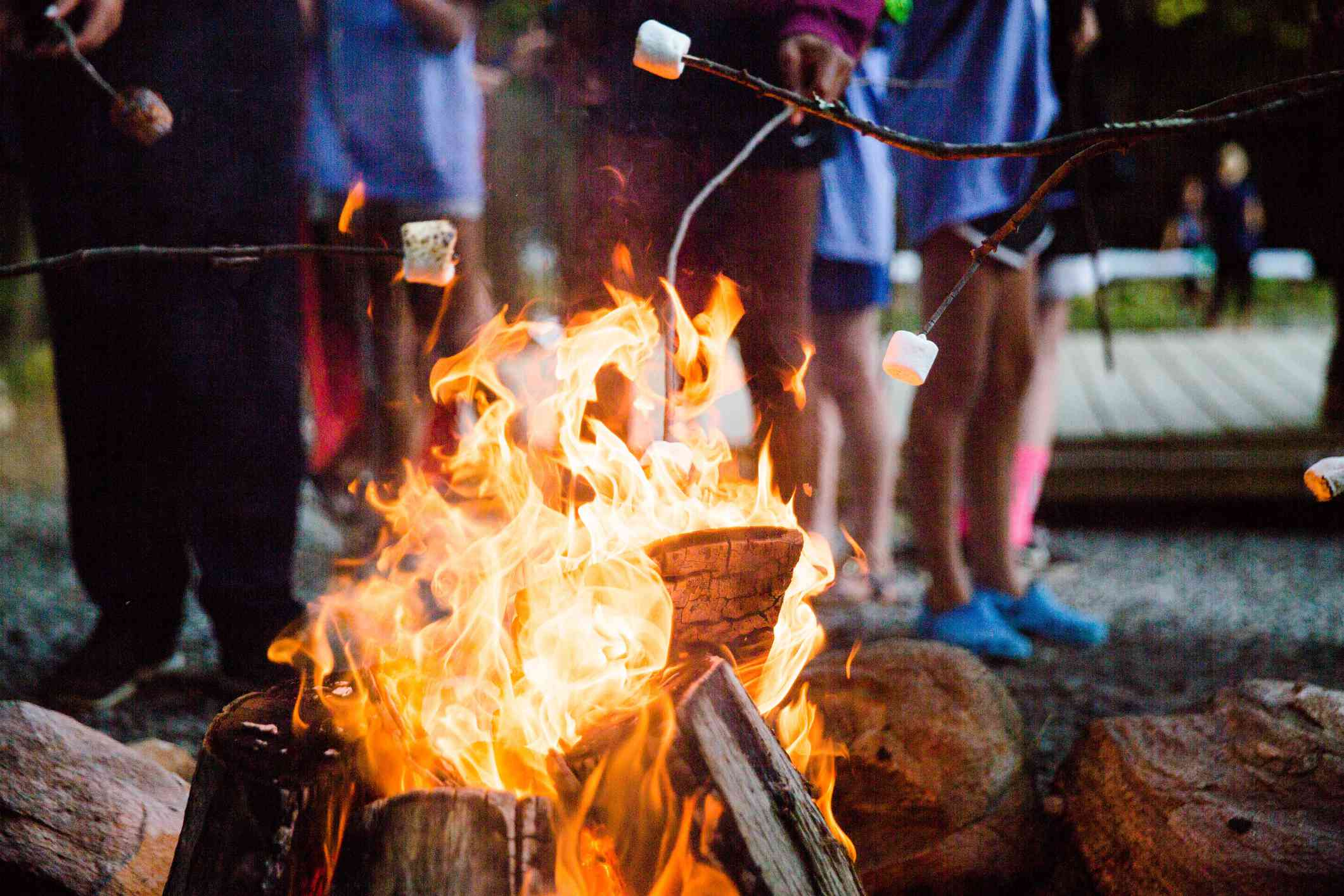 Roaring campfire with roasting marshmallows