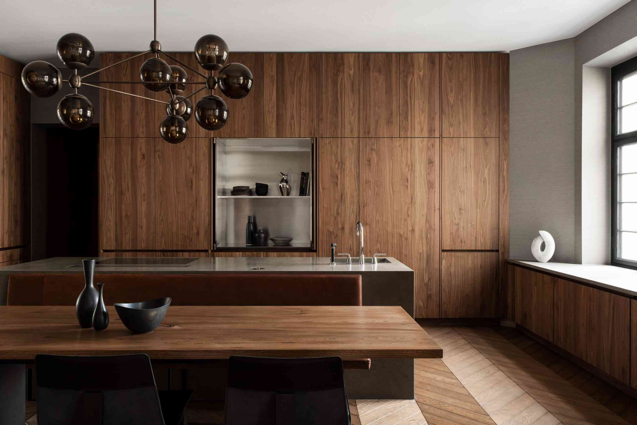 Kitchen with floor-to-ceiling wood cabinets