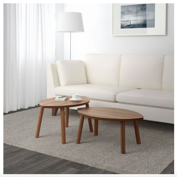 A set of two oval wooden nesting tables from IKEA.
