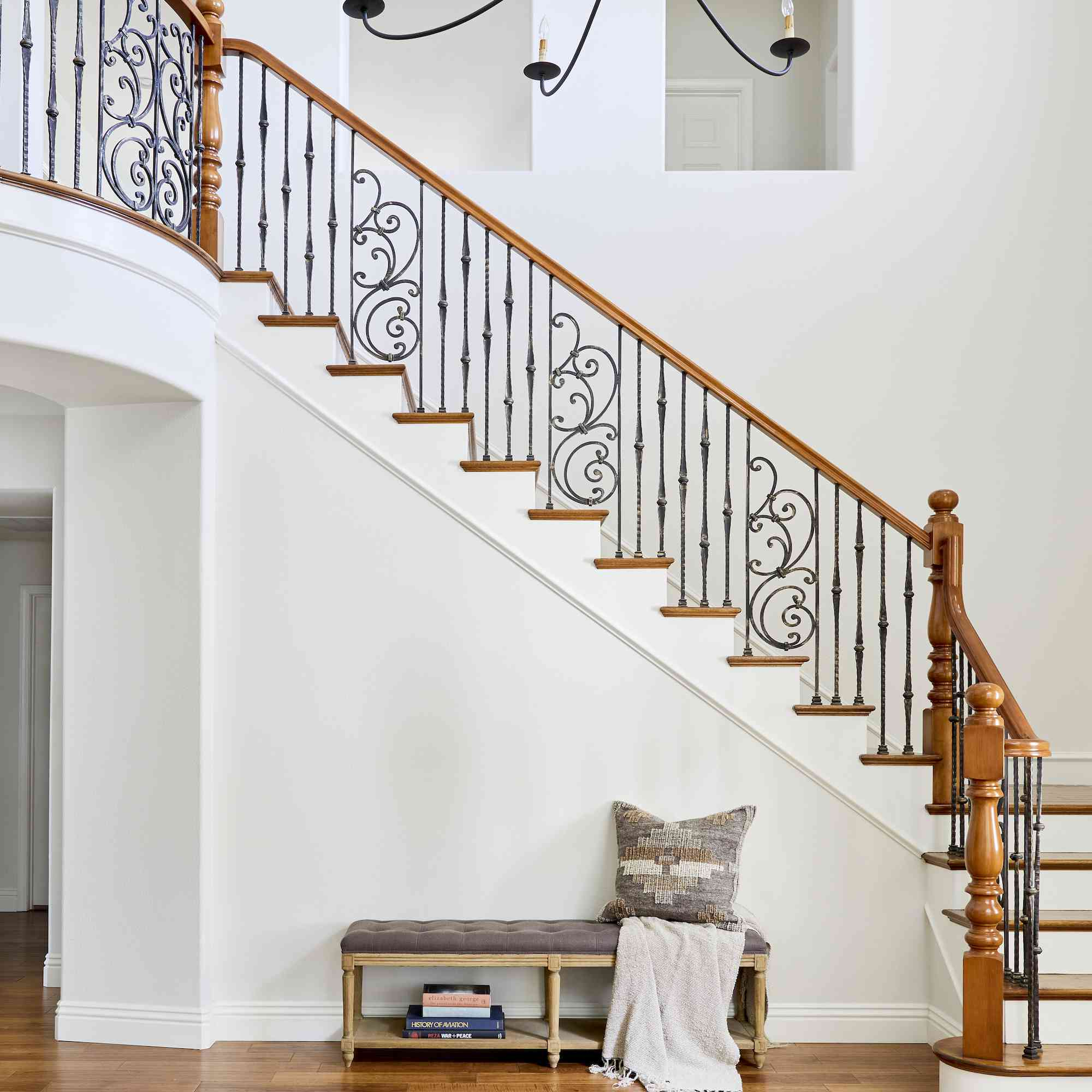 Grand staircase and small entryway bench.