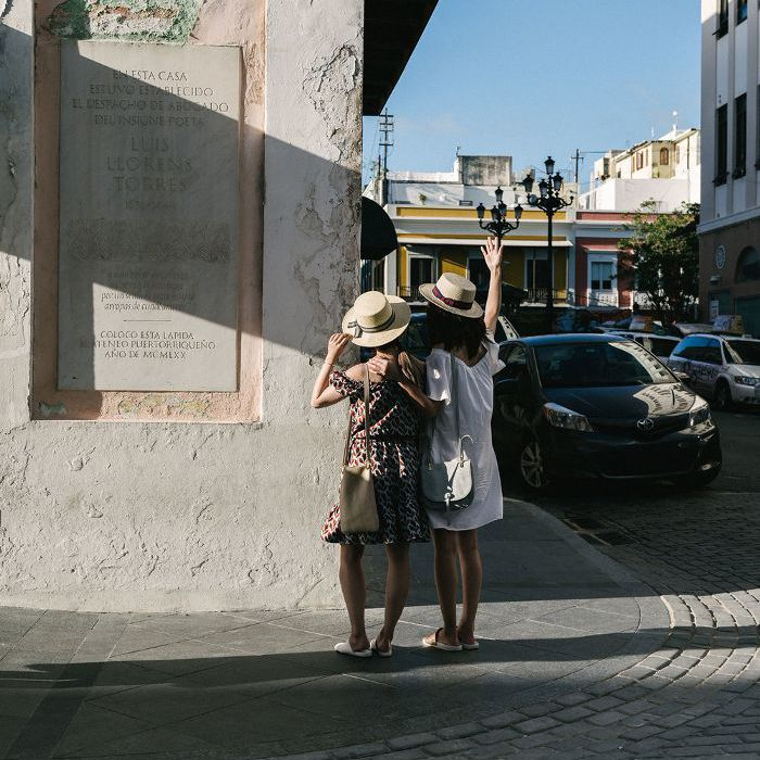 Two friends on Calle del Cristo in Puerto Rico's Old San Juan.
