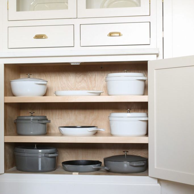 Cookware in cabinet.