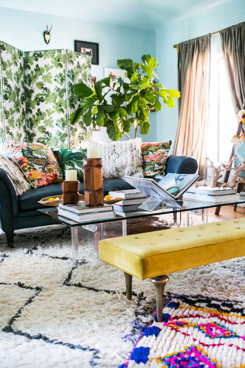 Bohemian living room with sky blue-painted walls, and a fiddle leaf fig