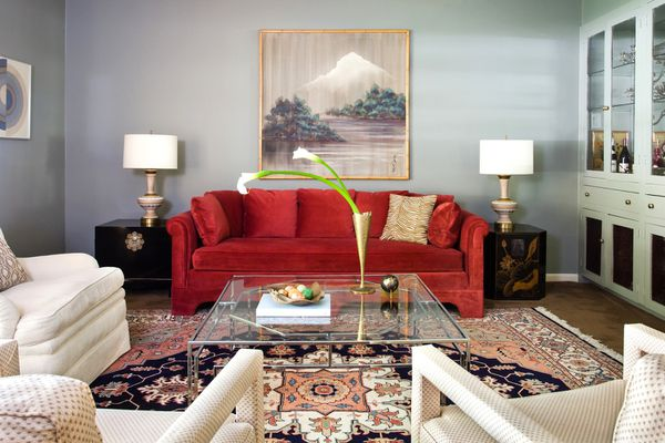 living room with ruby red sofa