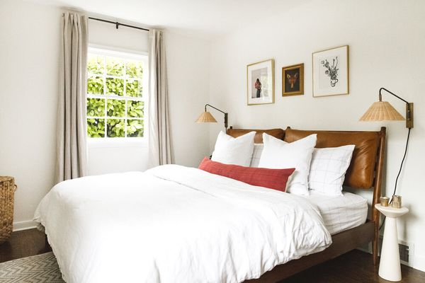 white bedroom with leather headboard