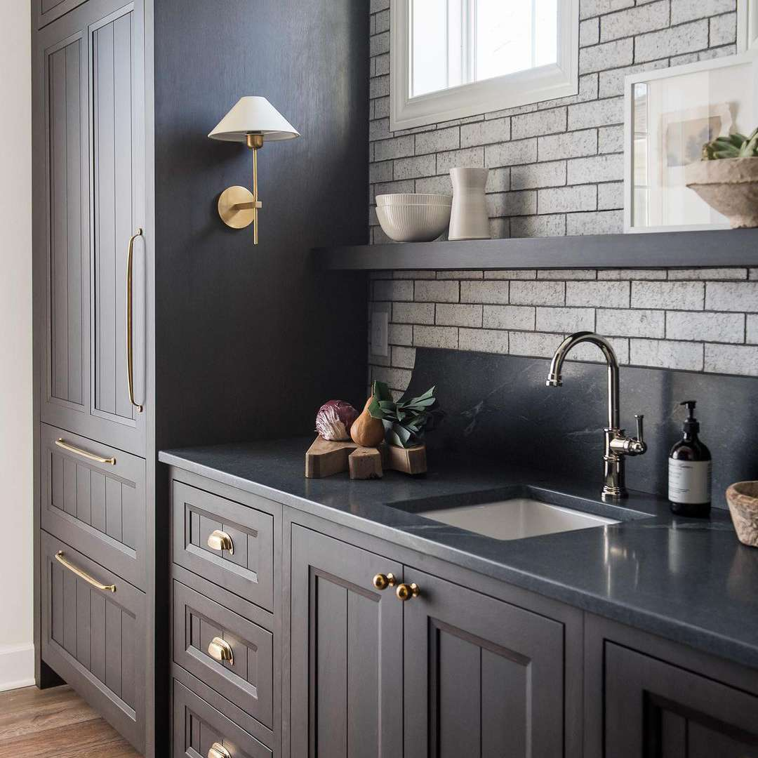 Black kitchen with soapstone counter