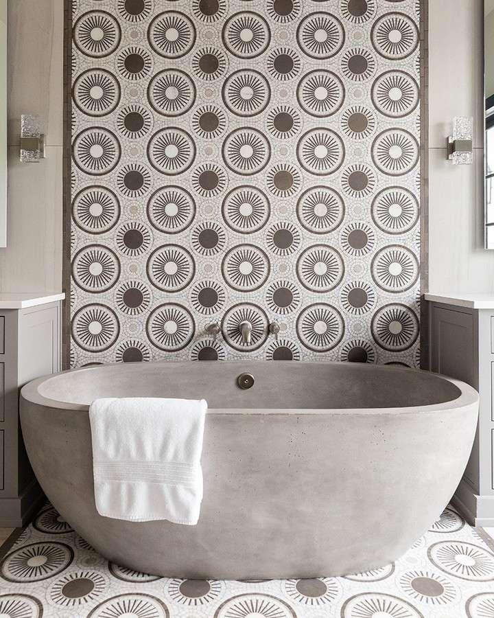 bathroom with stone tub and tiled backsplash