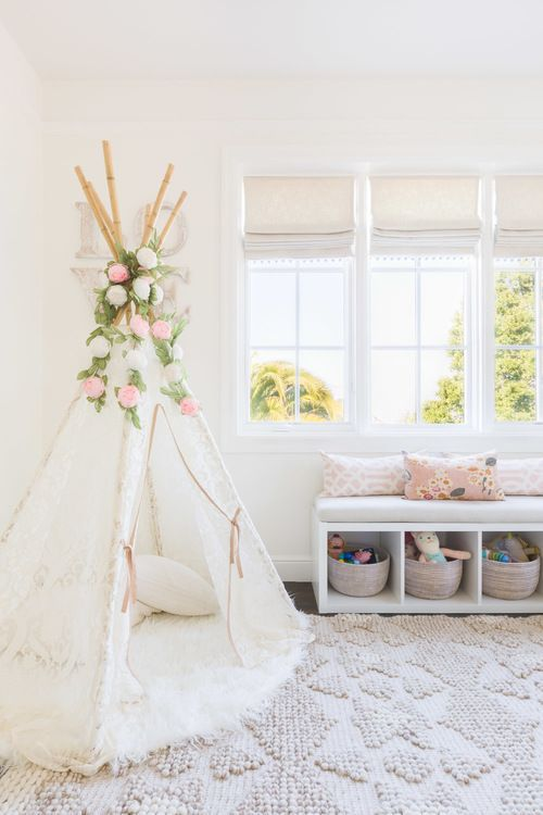 bright nursery with a floral teepee