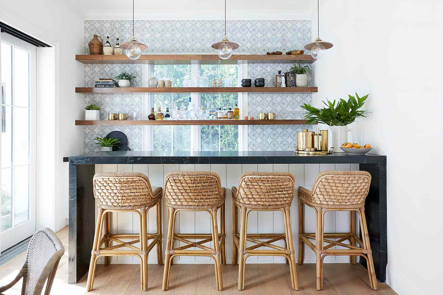 A wet bar lined with blue printed tiles