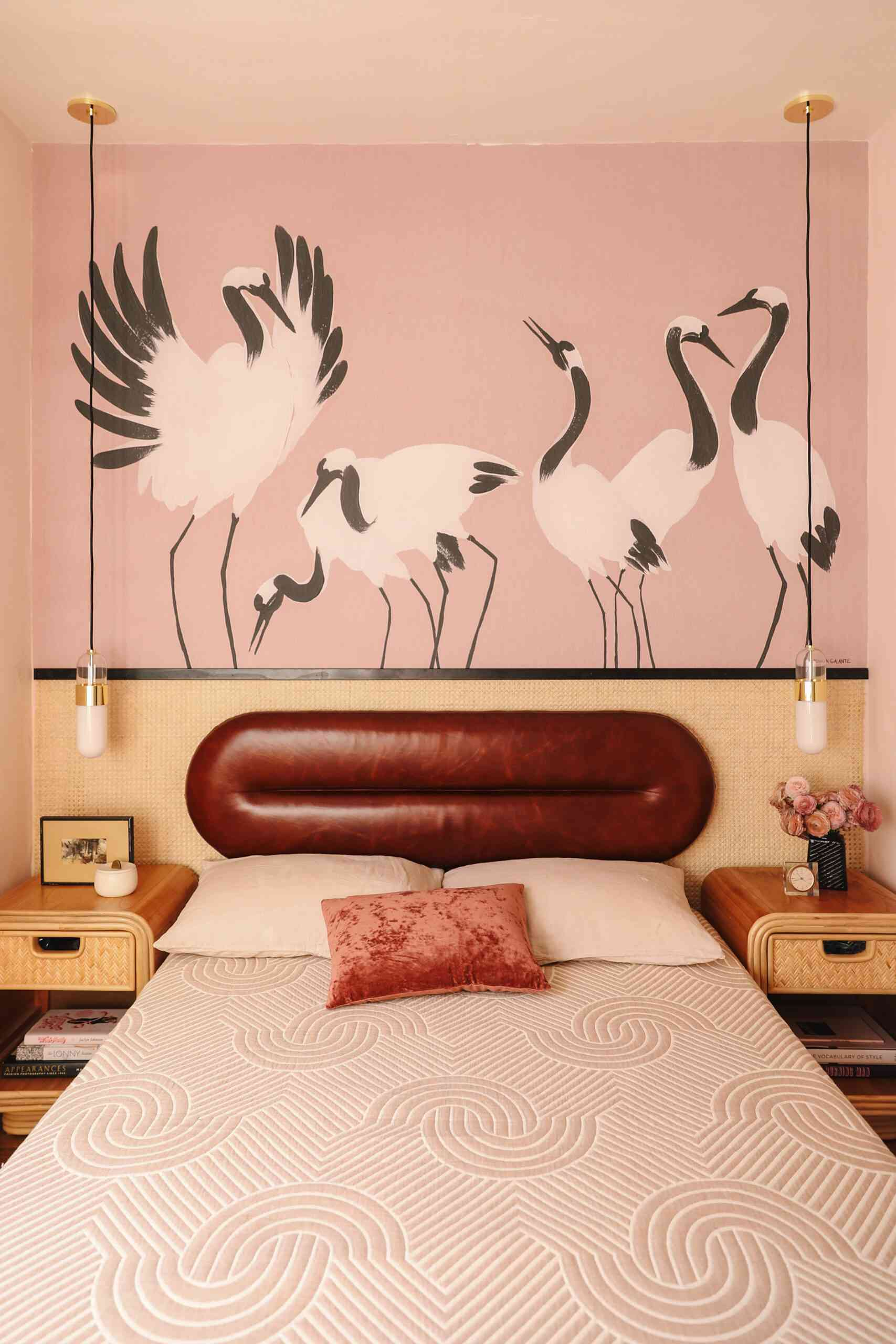 primary pink bedroom with crane mural and leather headboard