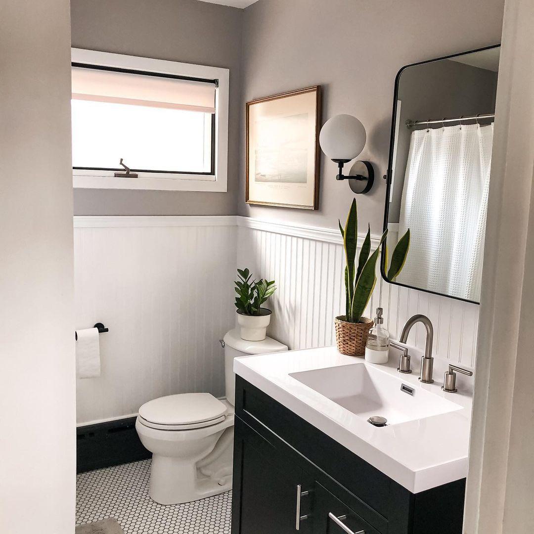 Modern bathroom with white beadboard.
