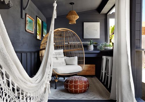 Boho patio space with egg chair and hammock.