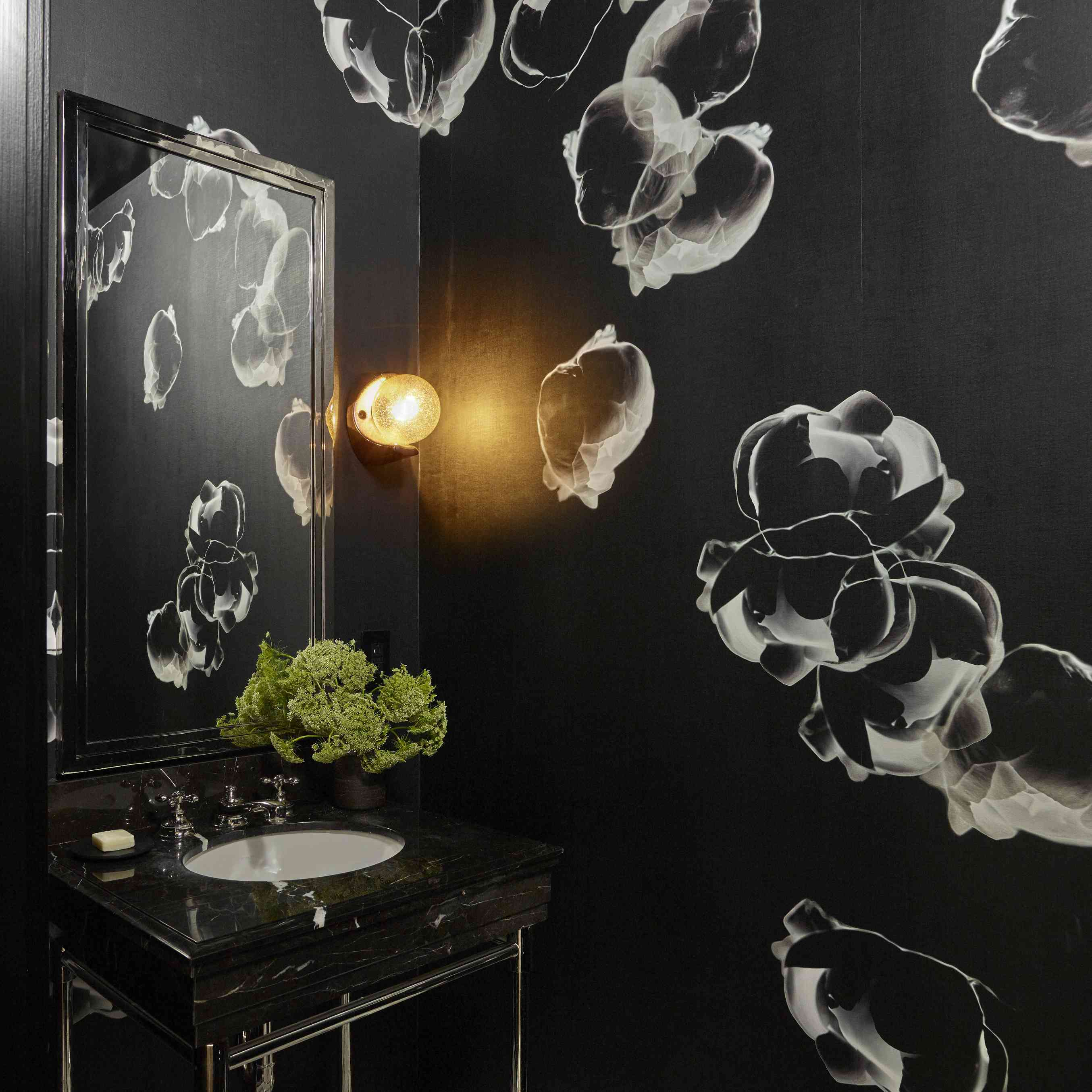 Bathroom with black and white wallpaper.
