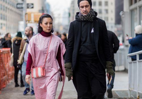 couple walking in street looking serious
