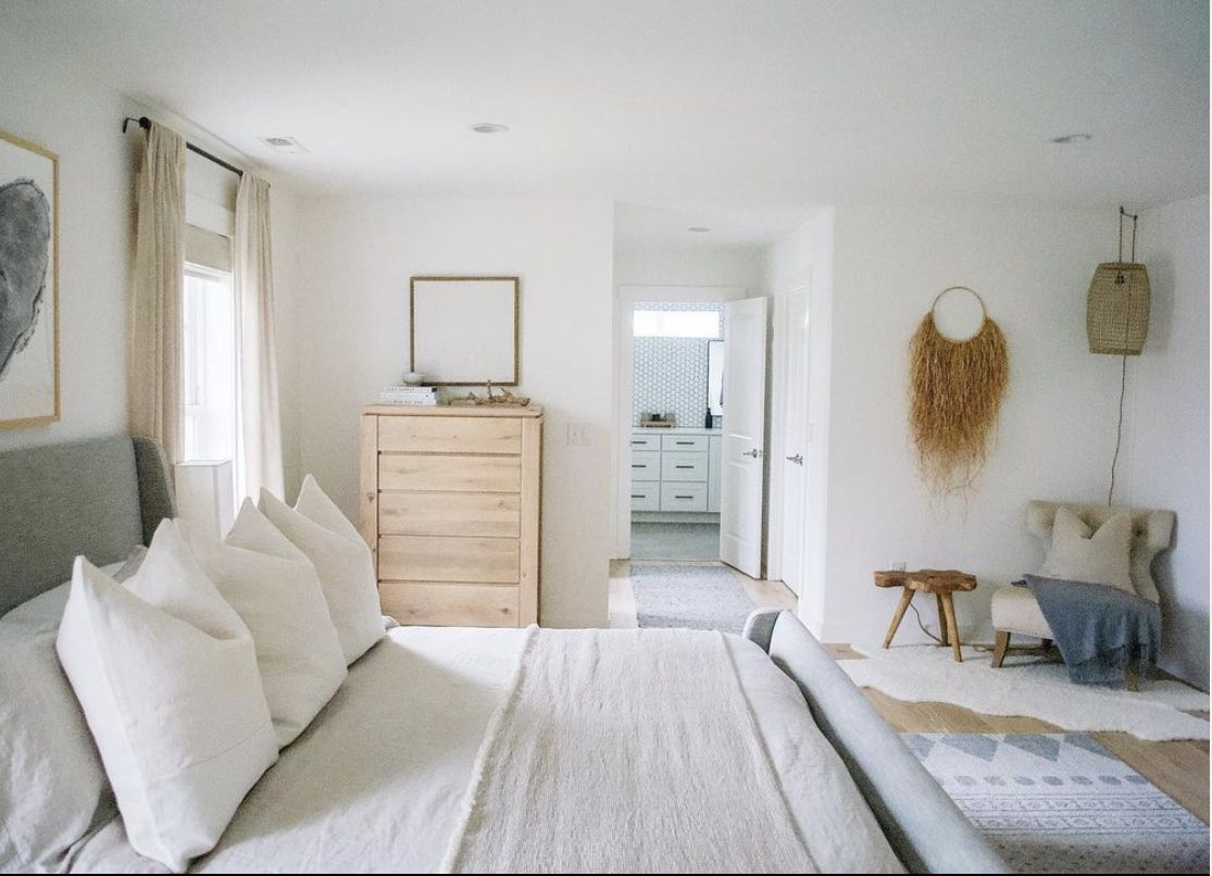 bedroom with linen and cotton sheets, white walls