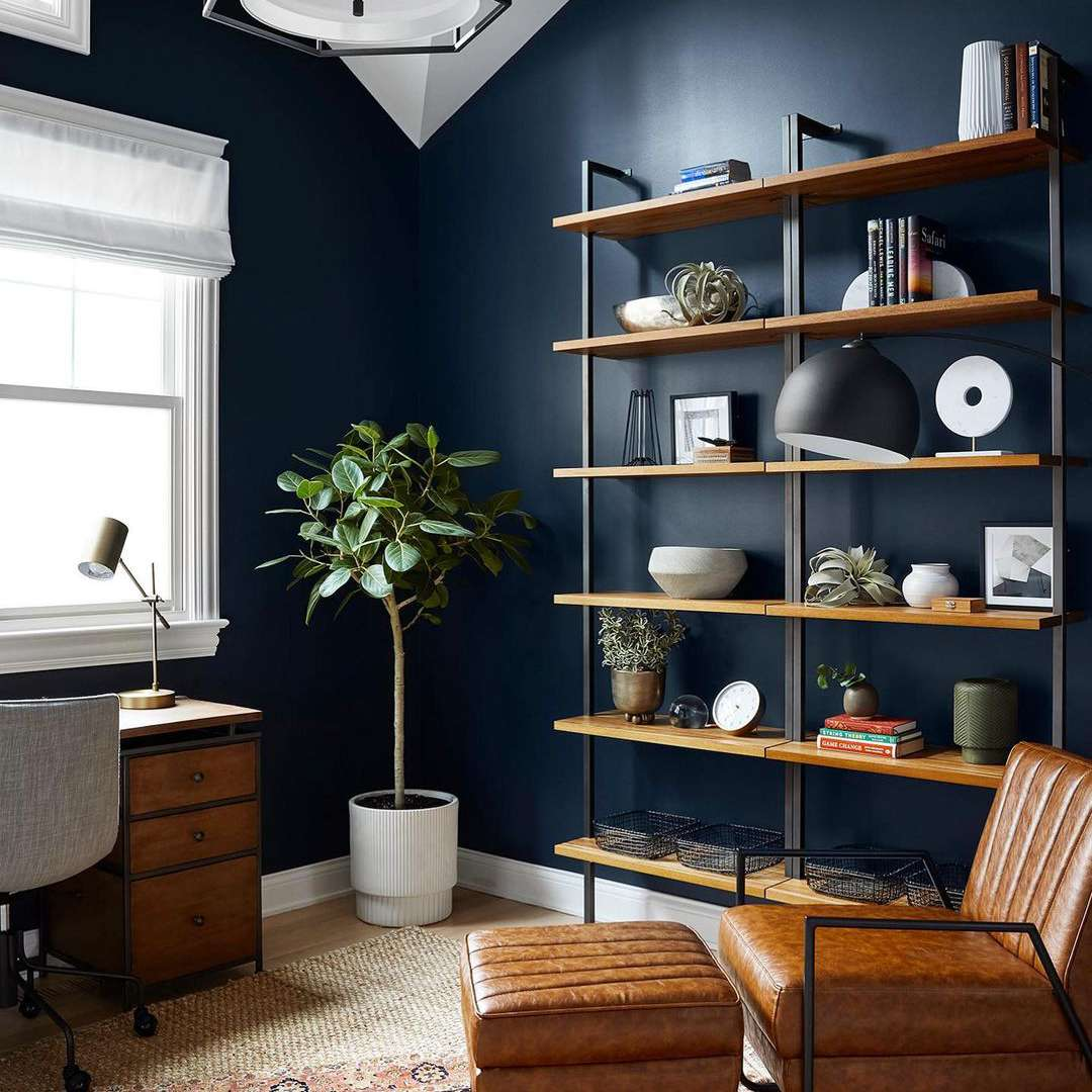Office with dark blue wall