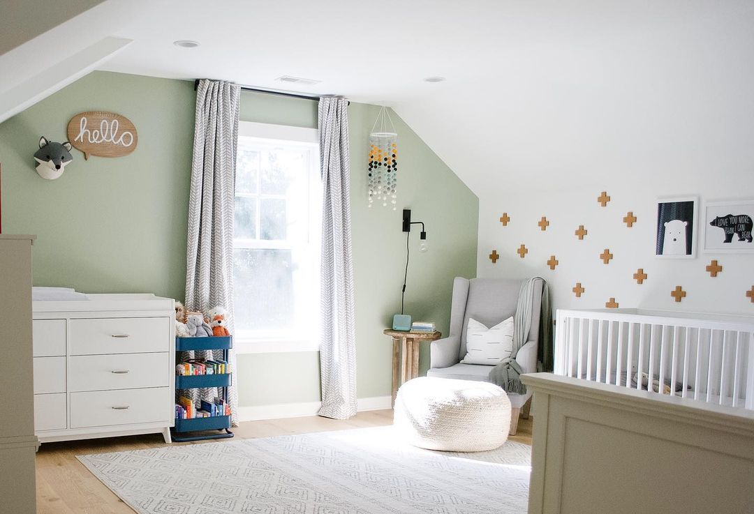 Green accent wall in nursery
