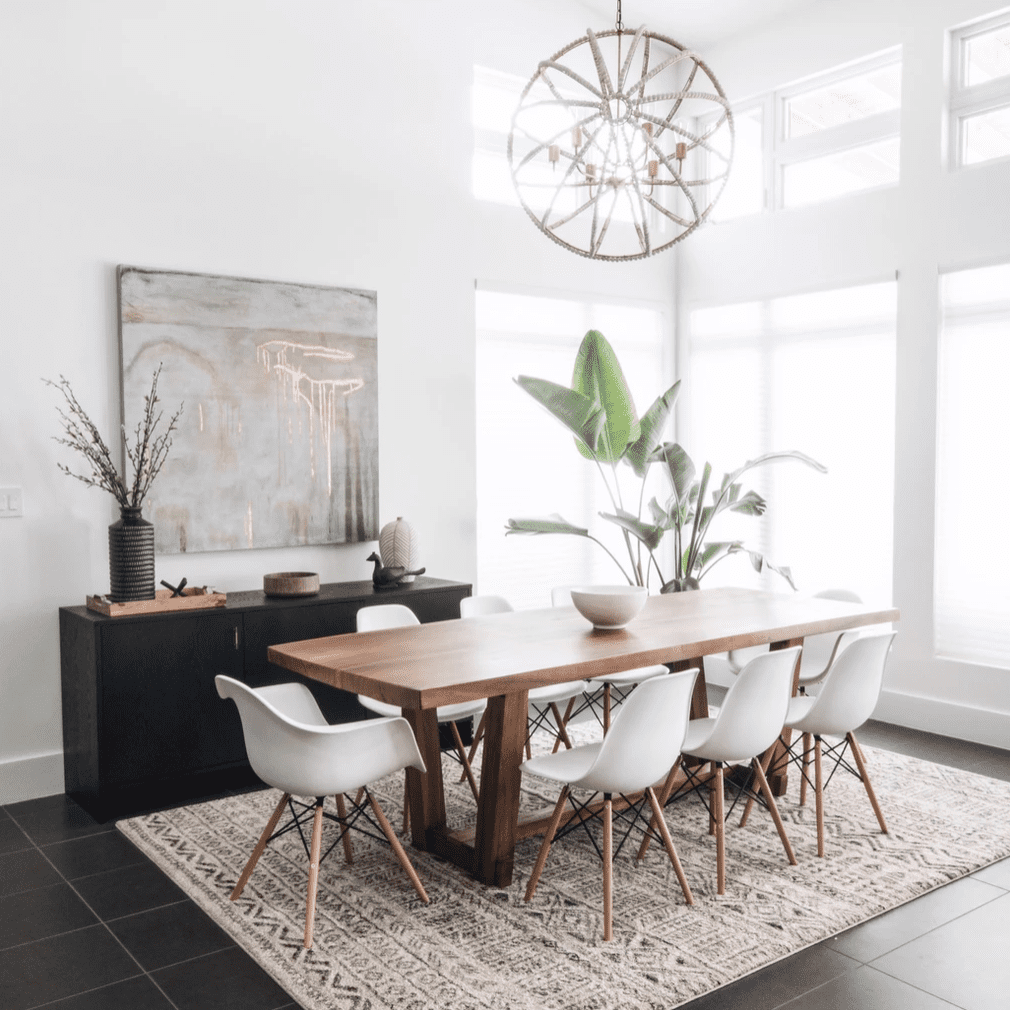 A dining room with a plush ivory rug