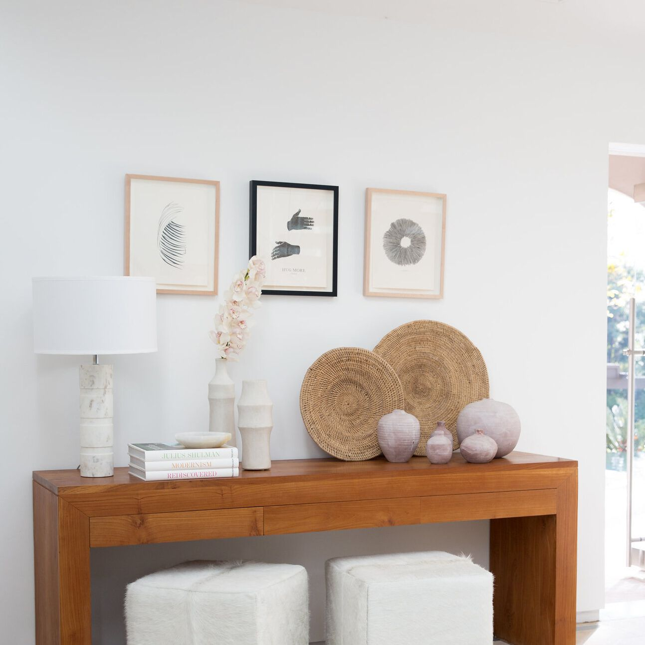 White wall with framed art