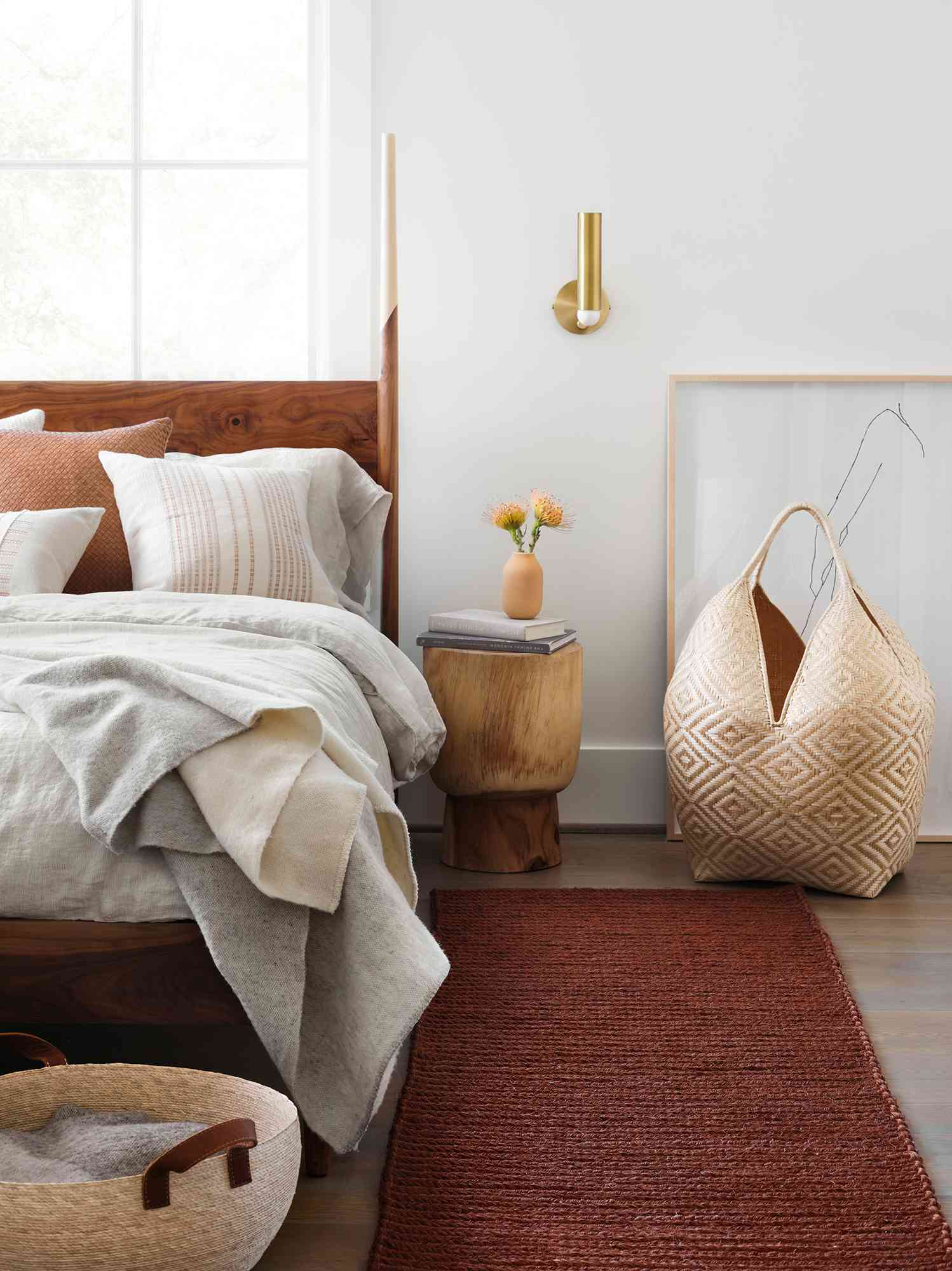 bedroom with wooden bedframe and woven accents