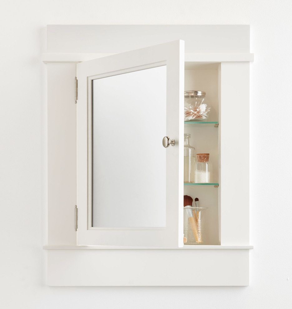 A white, wooden, mirrored medicine cabinet that's slightly ajar.