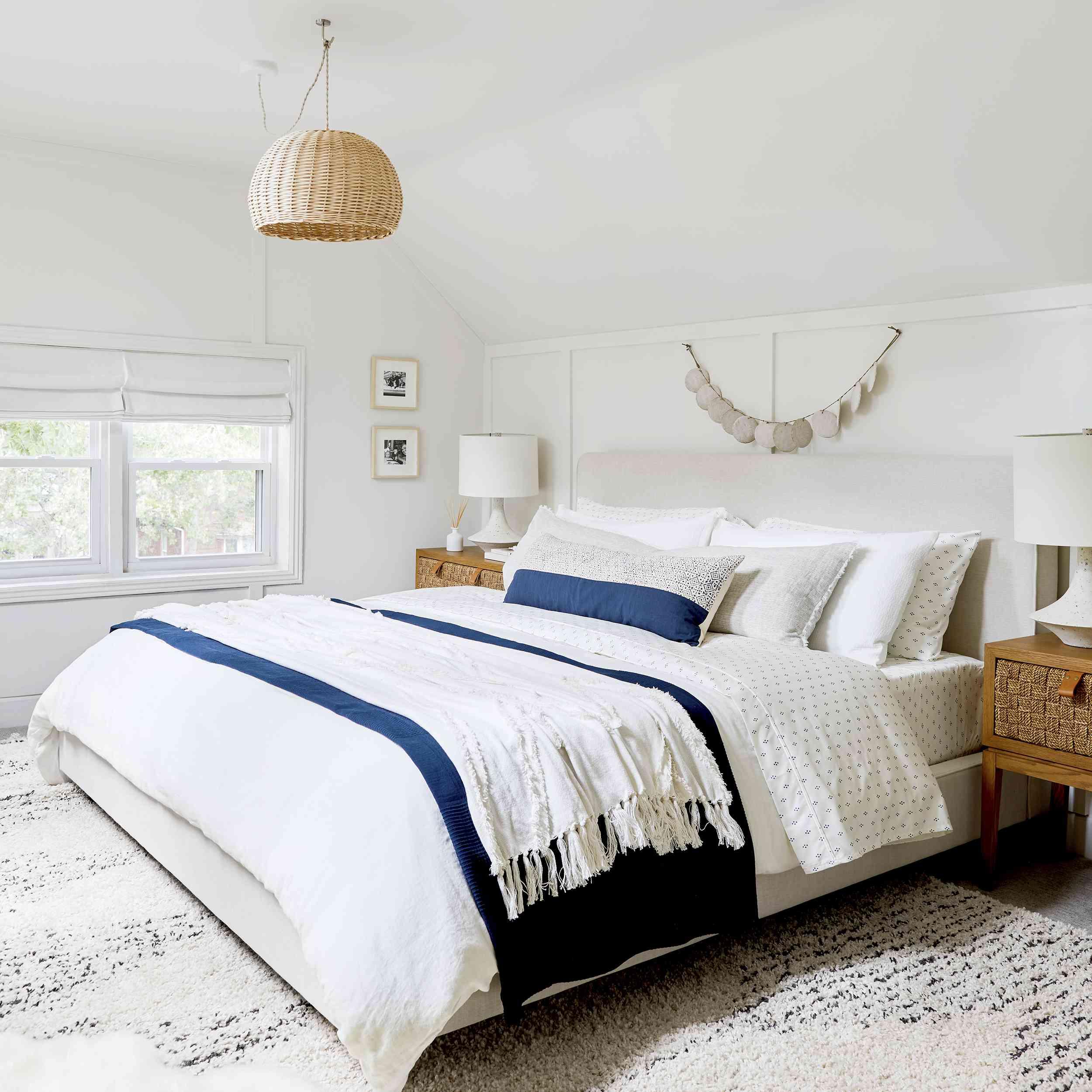 Fresh, white, symmetrical bedroom
