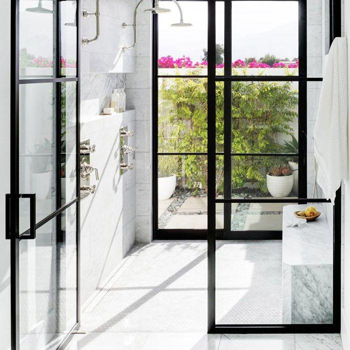 marble bathroom with matte black shower door frame