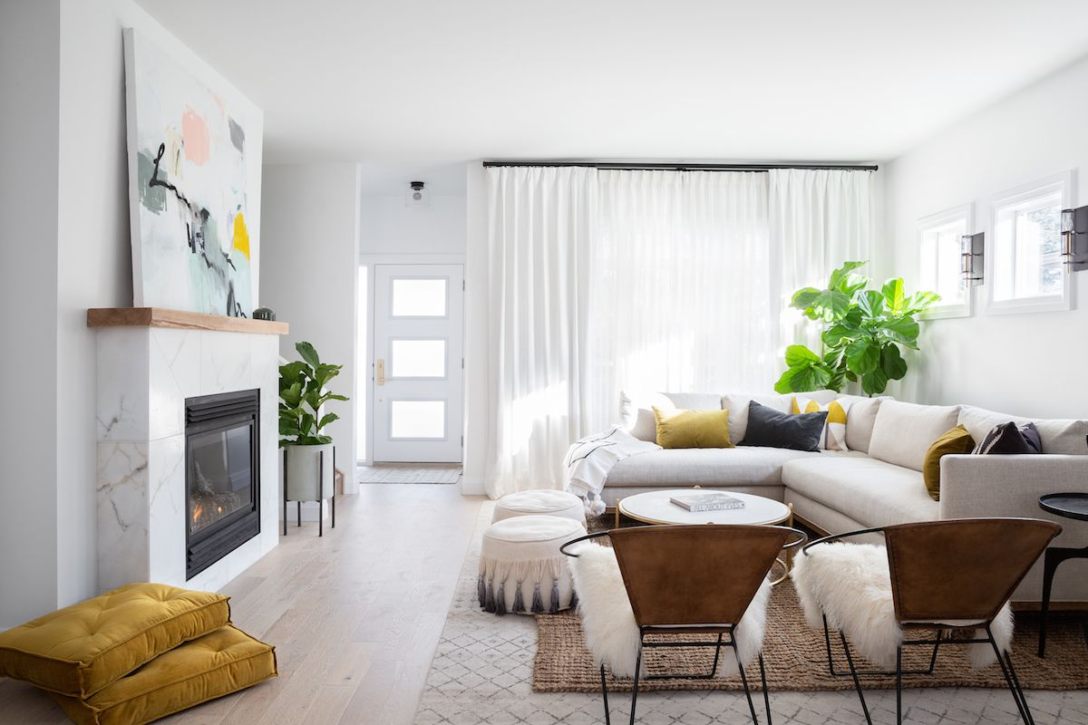 White living room with long white drapes.