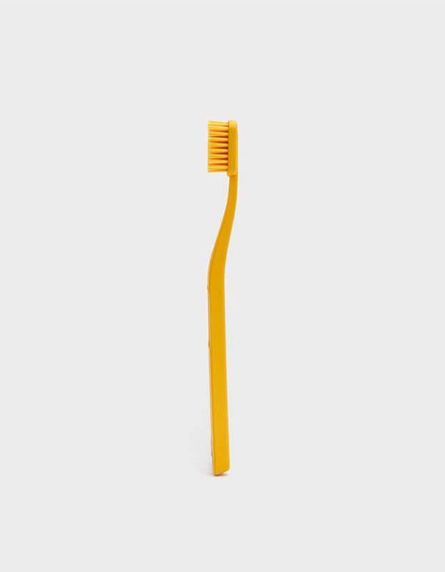 Yellow plastic toothbrush