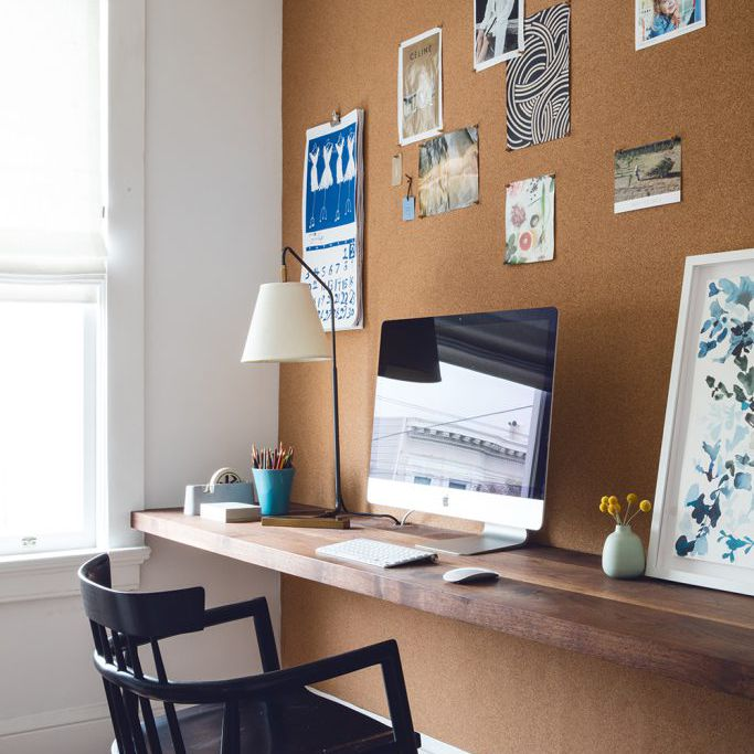 Office space with mustard accent wall.