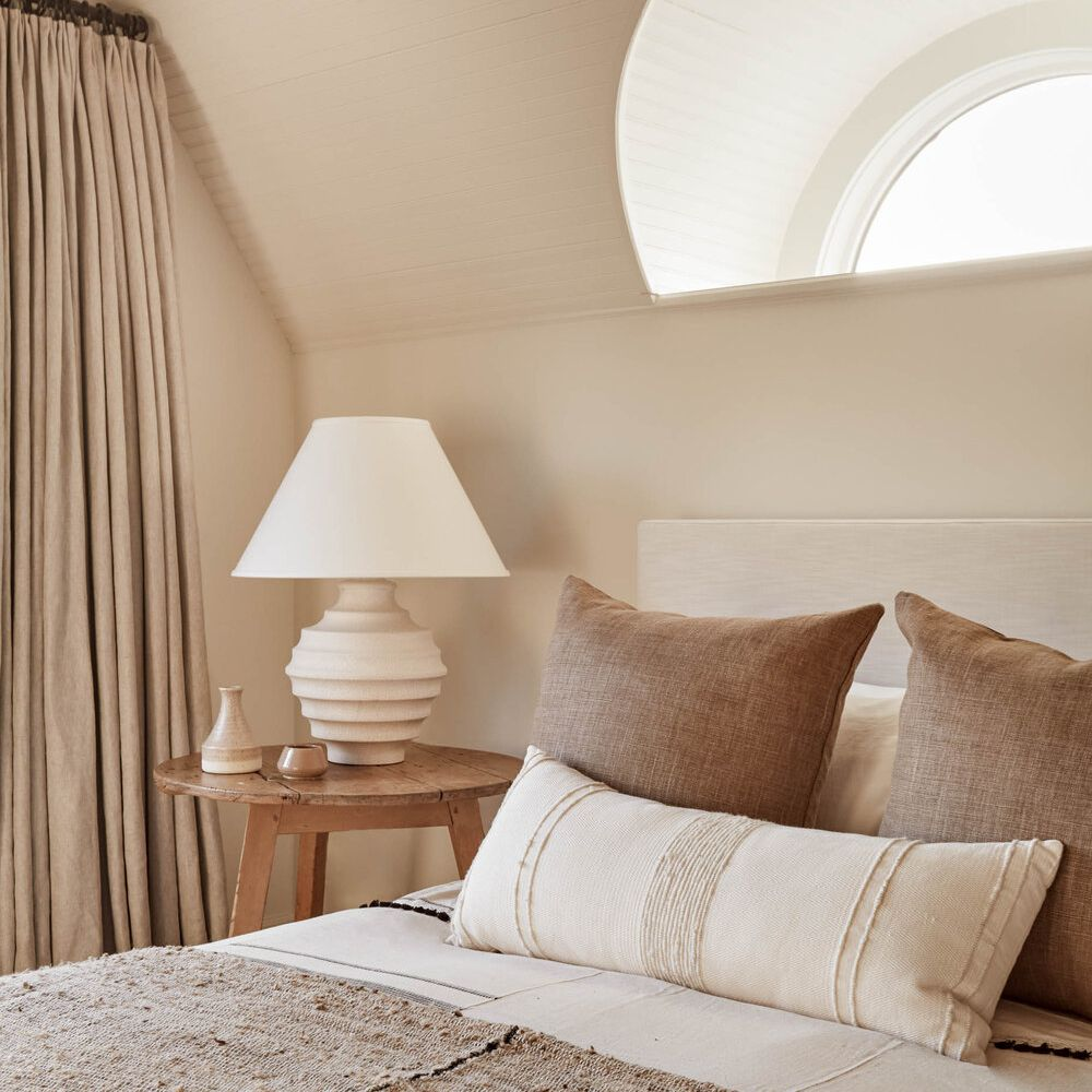 A bedroom with warm beige walls