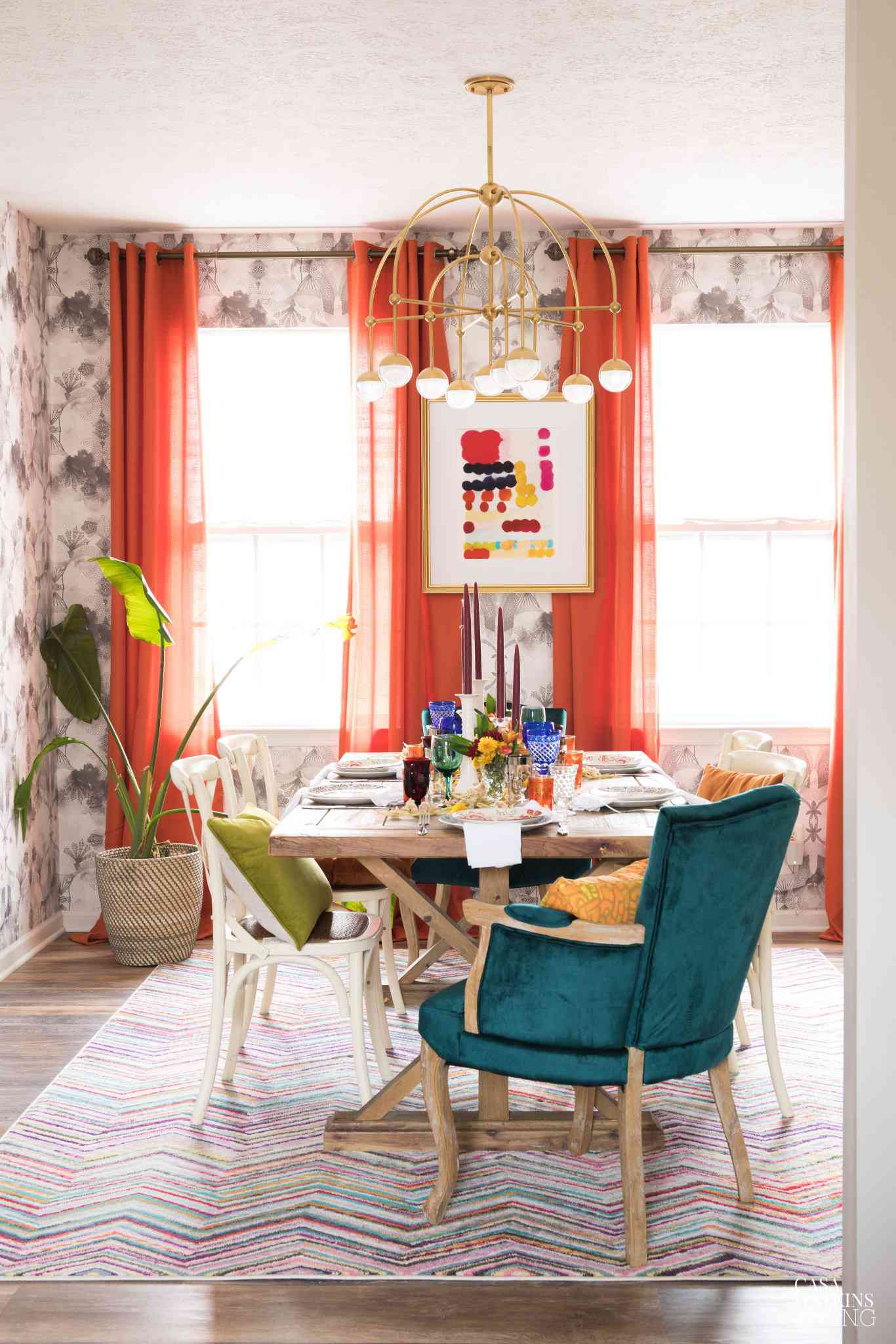 Dining room with orange-red curtains