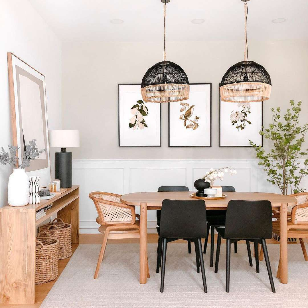 Scandi-inspired dining room with light neutrals and black chairs.