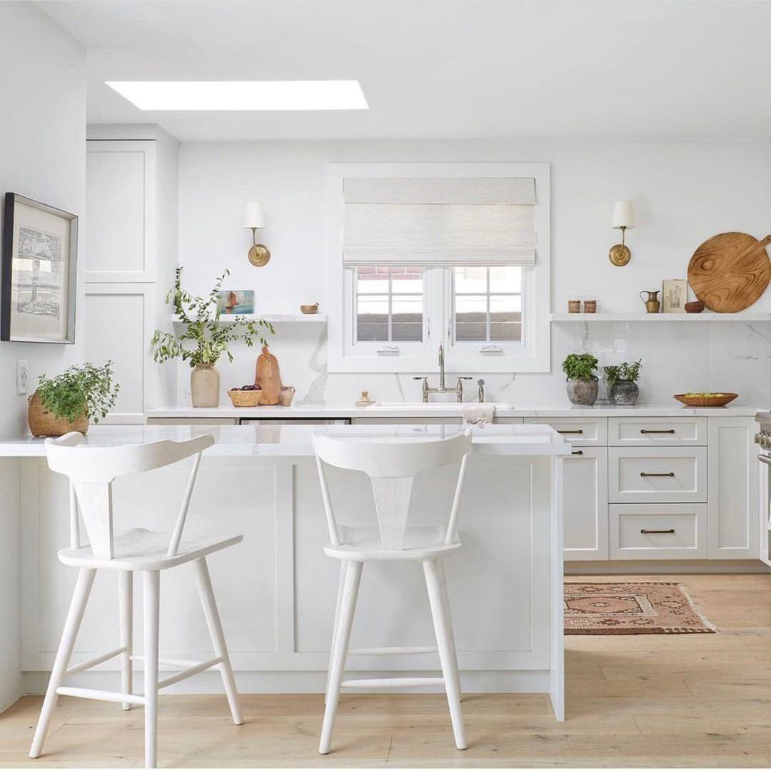 White kitchen with rug