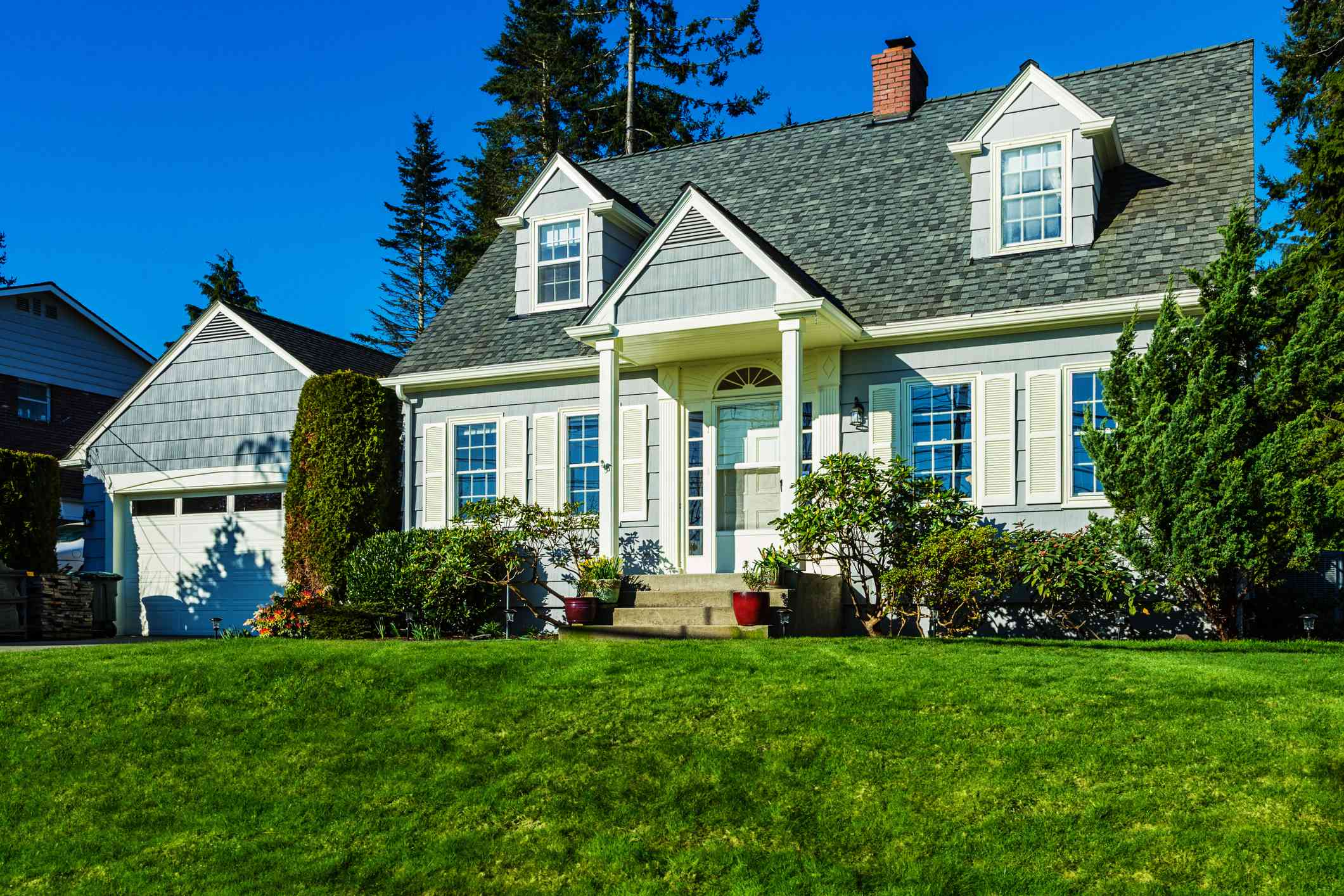 what is a cape style house? cape cod home with siding and dormer windows
