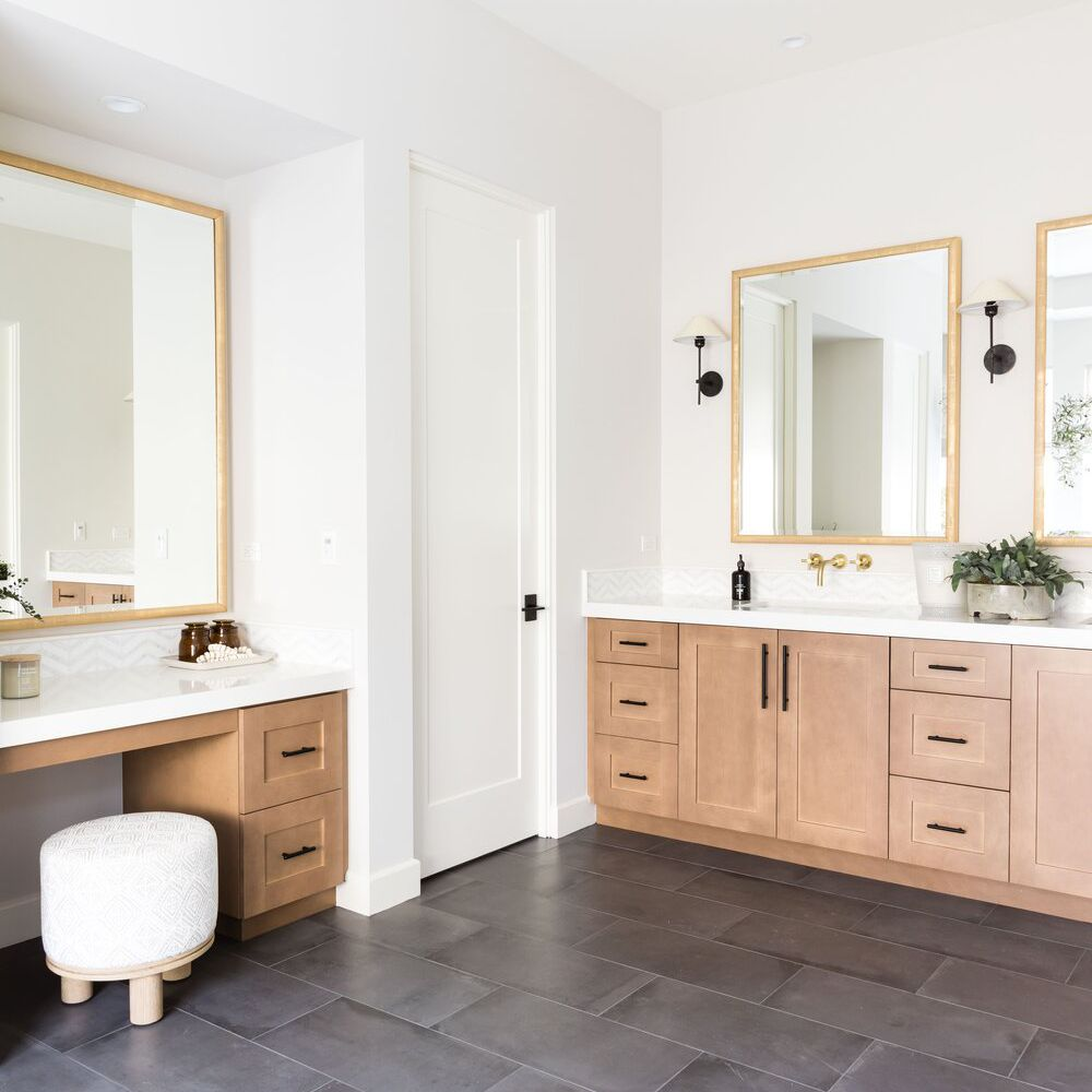 A double vanity extended across a corner