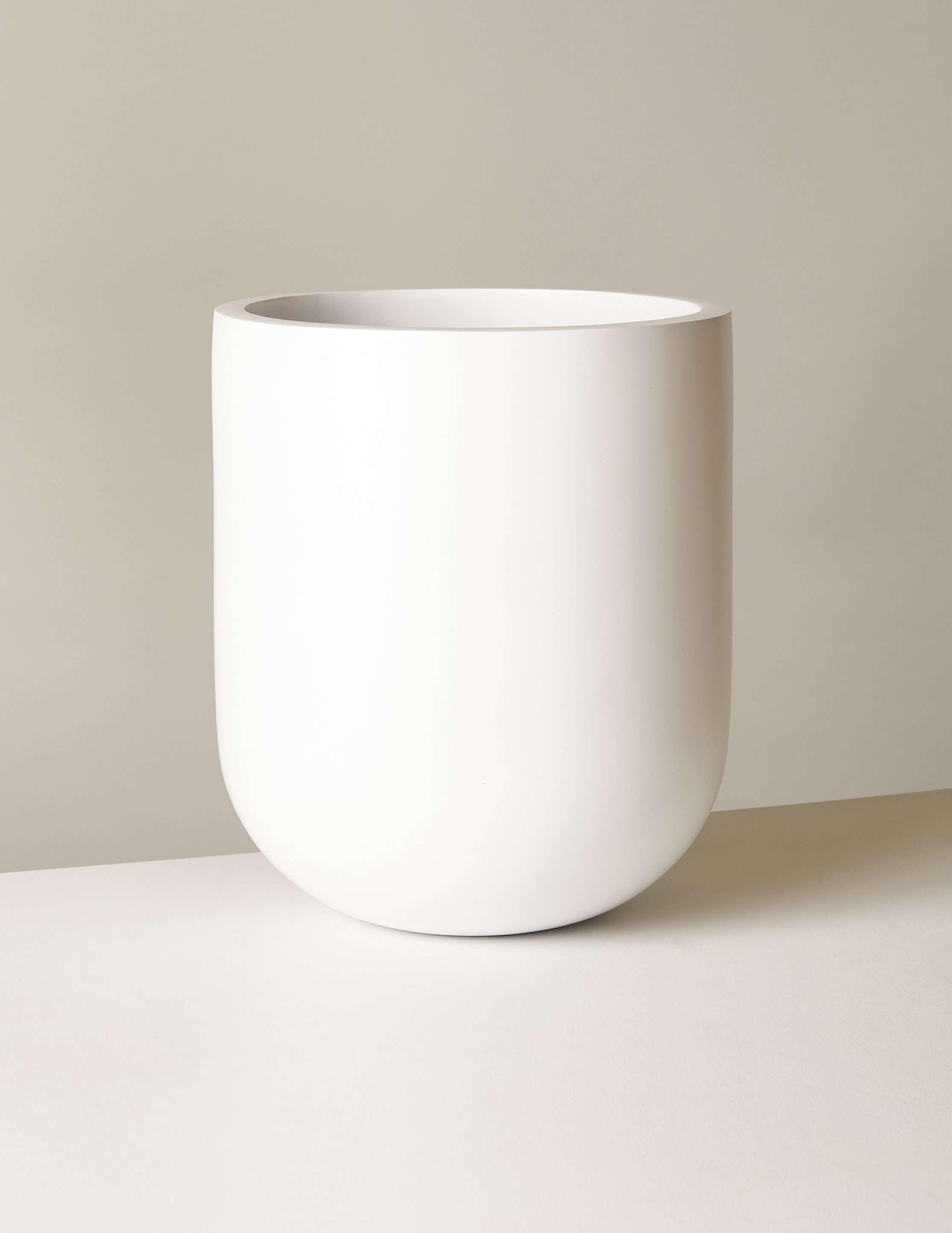 A large white fiberglass planter.