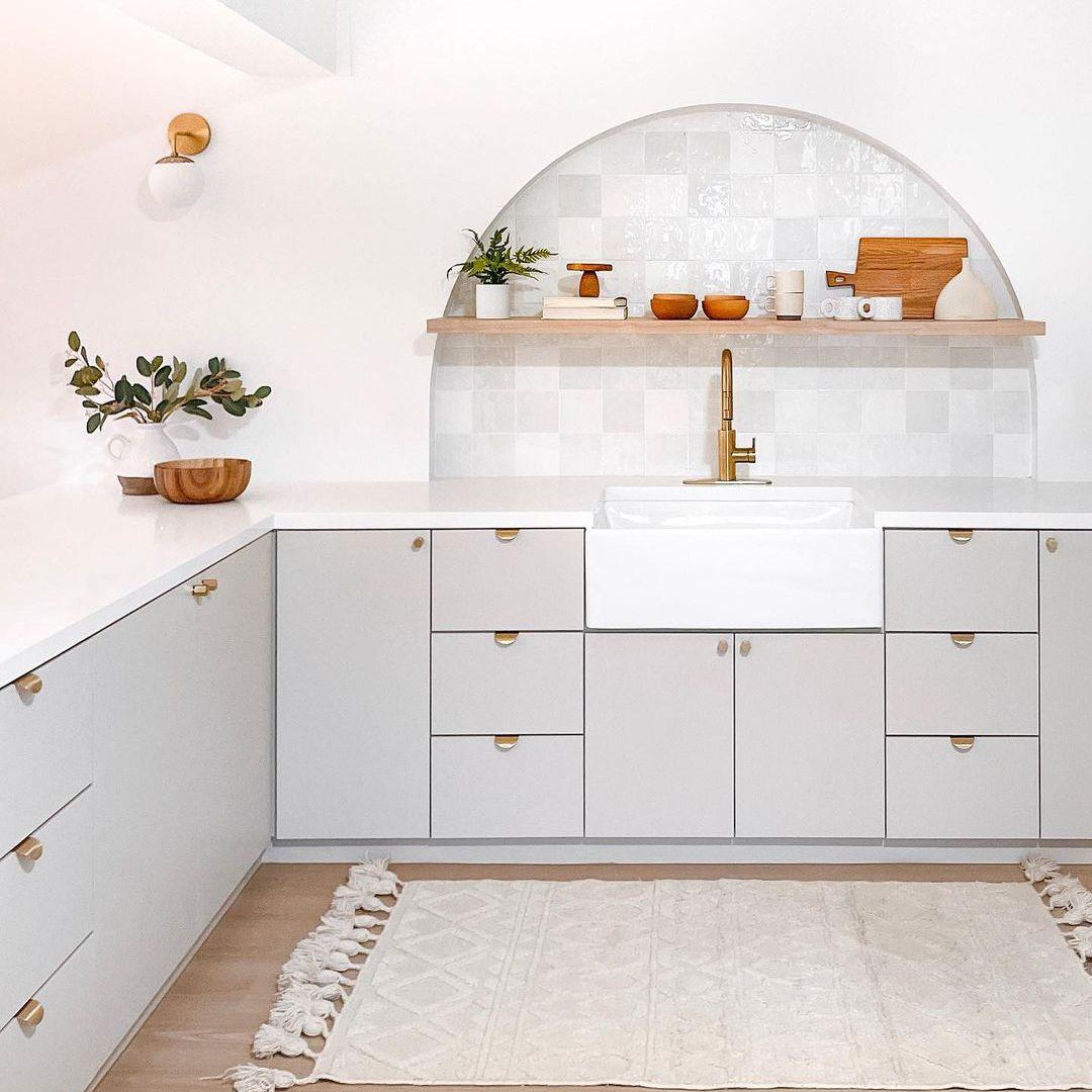 Soft neutral kitchen with jute rug.