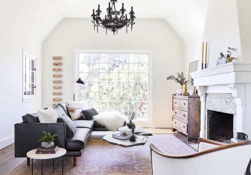 living room with black couch and black chandelier
