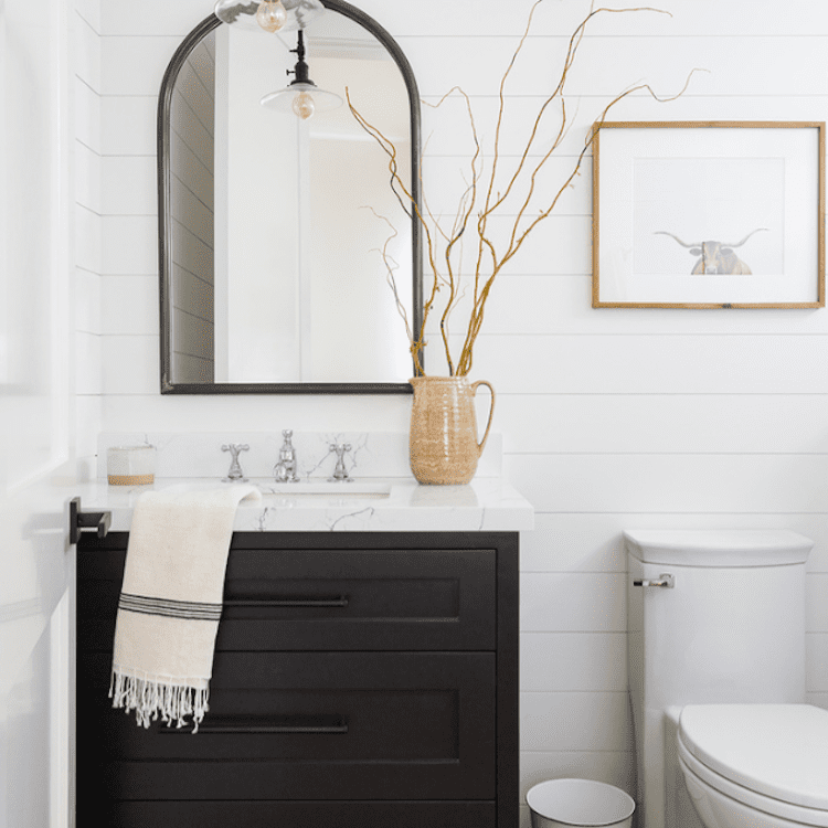 A powder room with decorative branches in it