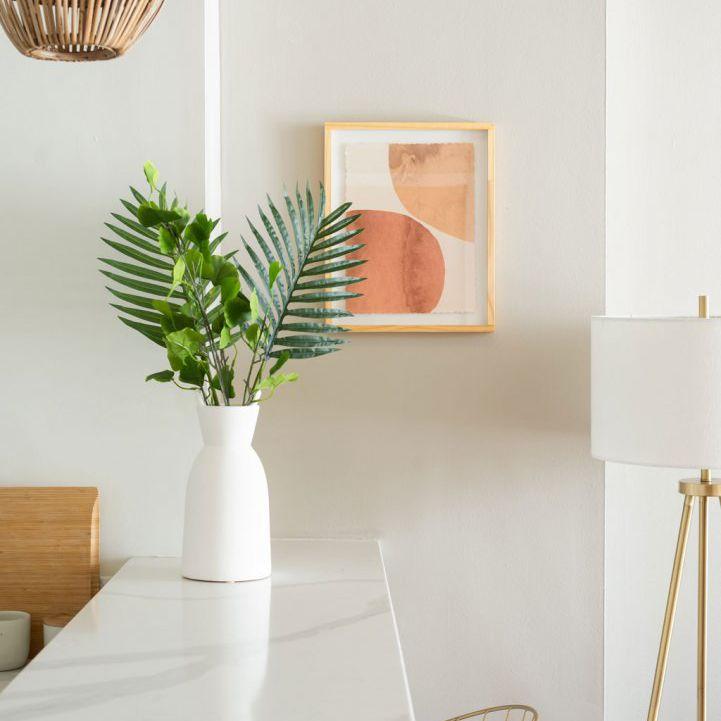 A white kitchen with graphic orange art