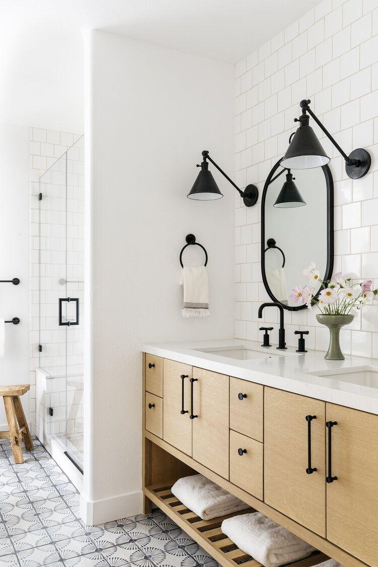 Modern bathroom with white subway tile, light wood vanity