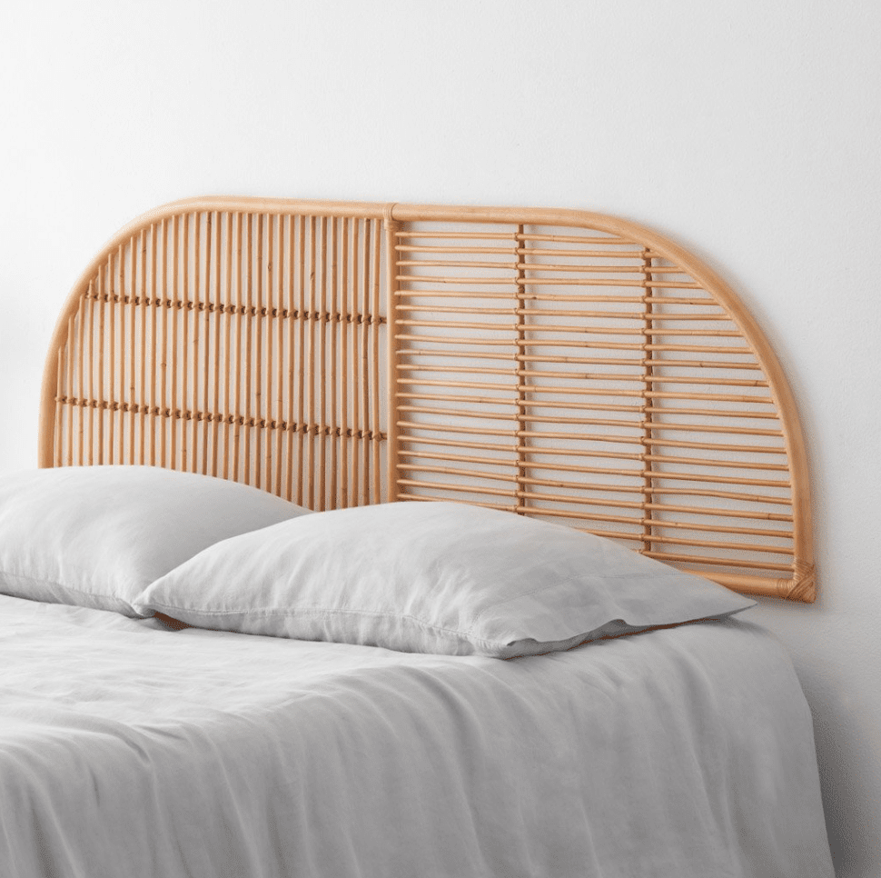 A curved rattan headboard