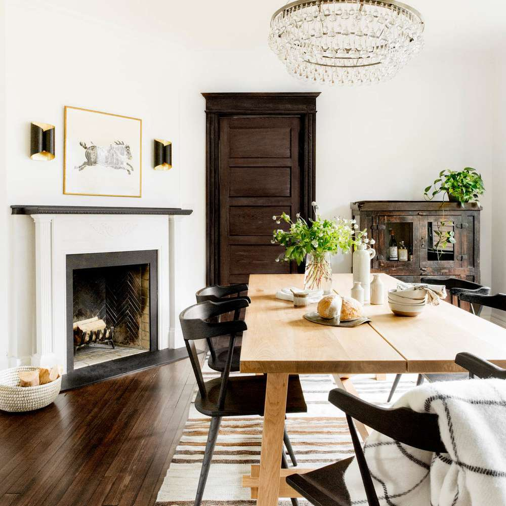 A contemporary dining room with a classic chandelier