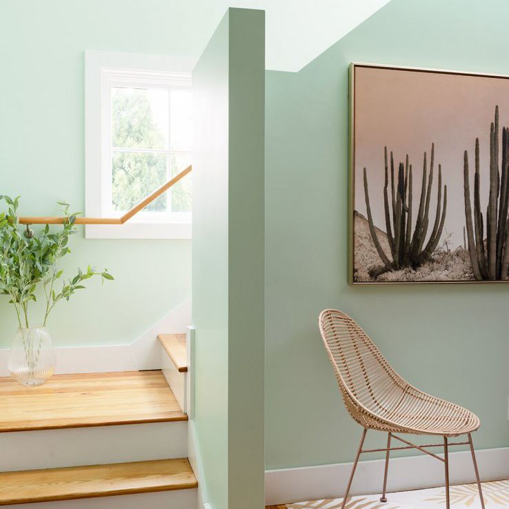 how to clean walls - stairs with light green walls