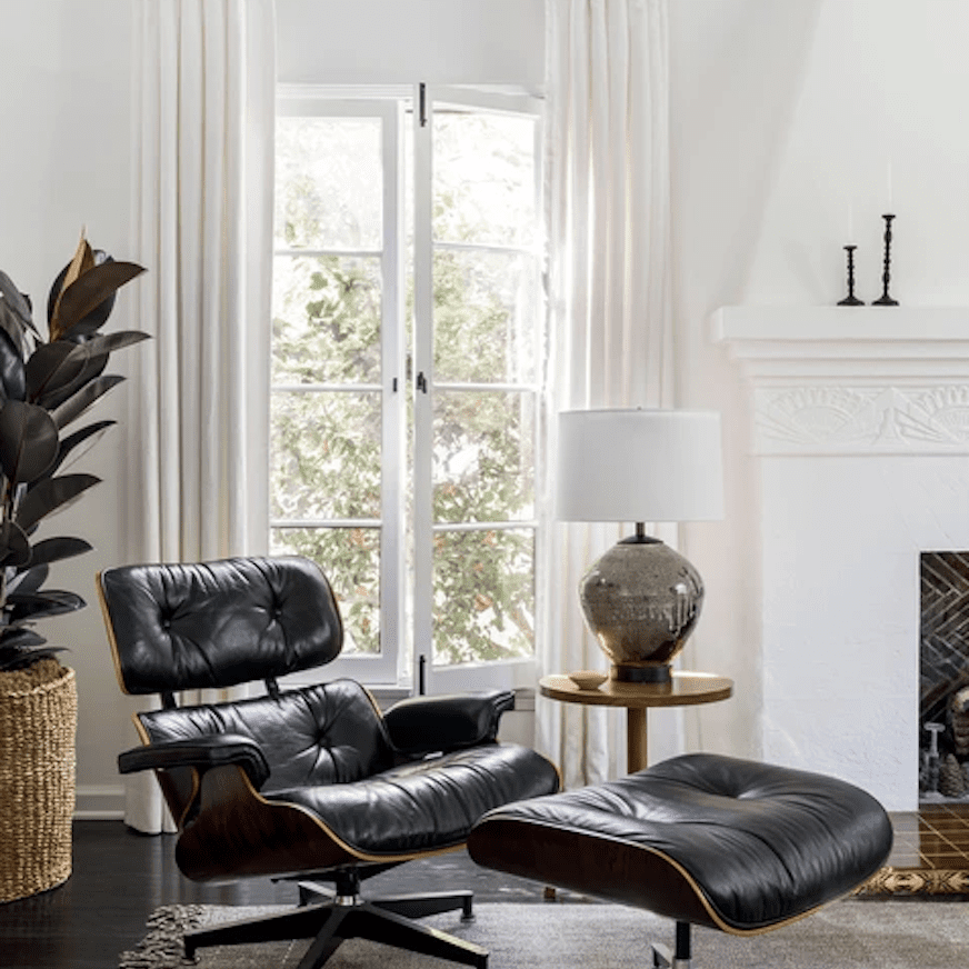 Living room featuring eames lounge chair and ottoman