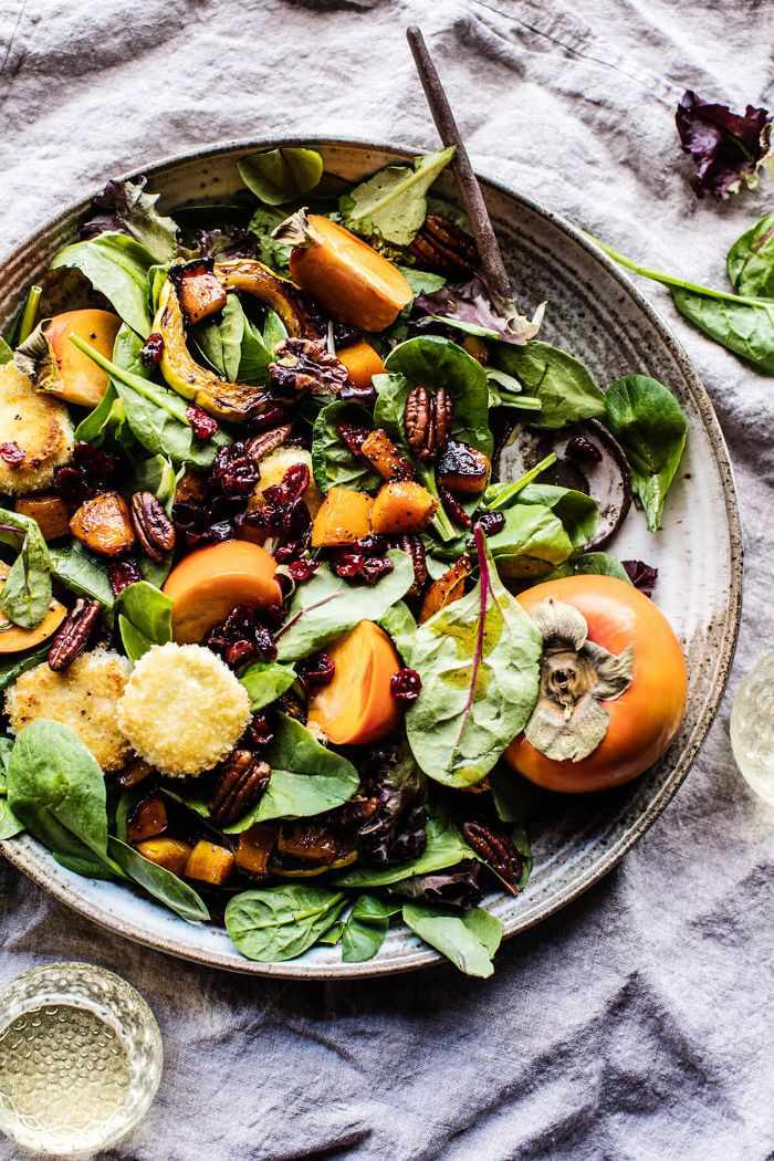 a persimmon, nut salad