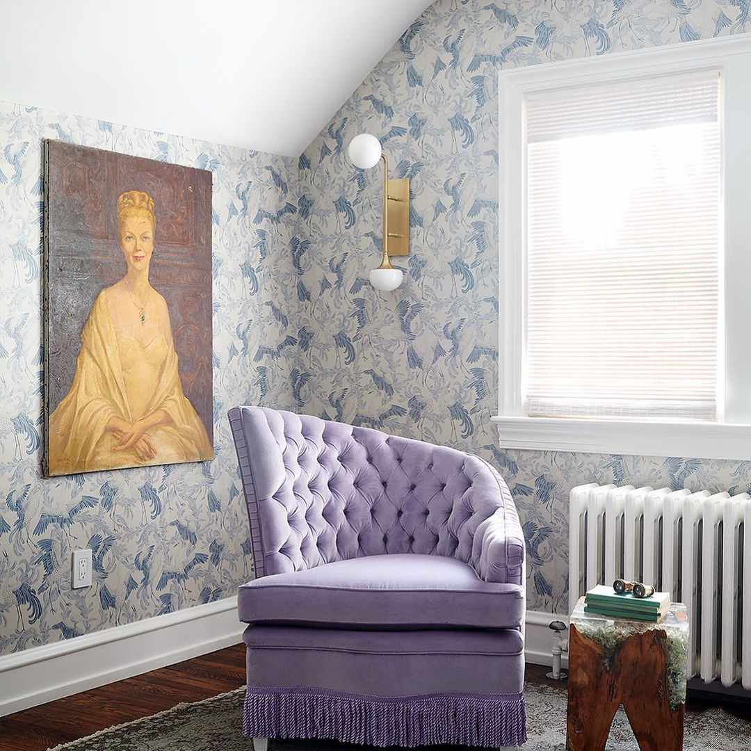 Regency inspired reading nook with blue floral wallpaper and purple chair