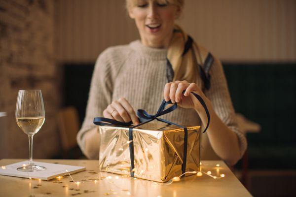 woman opening birthday gift